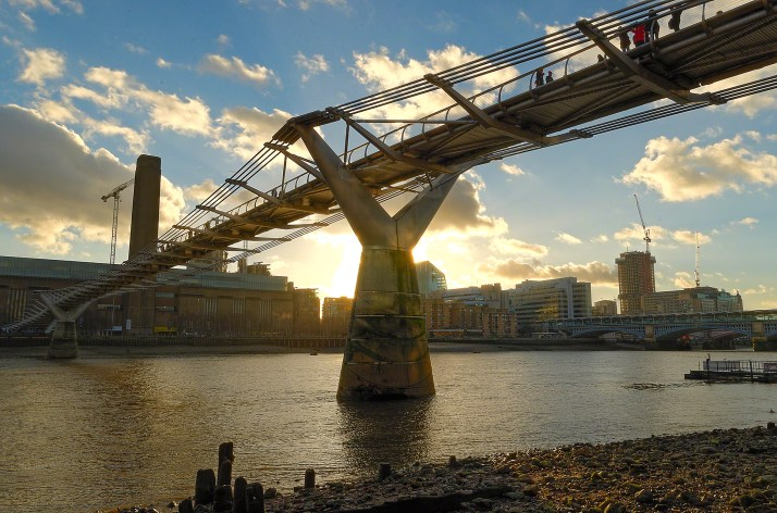 Millenium Bridge over the river Thames, London at sunset