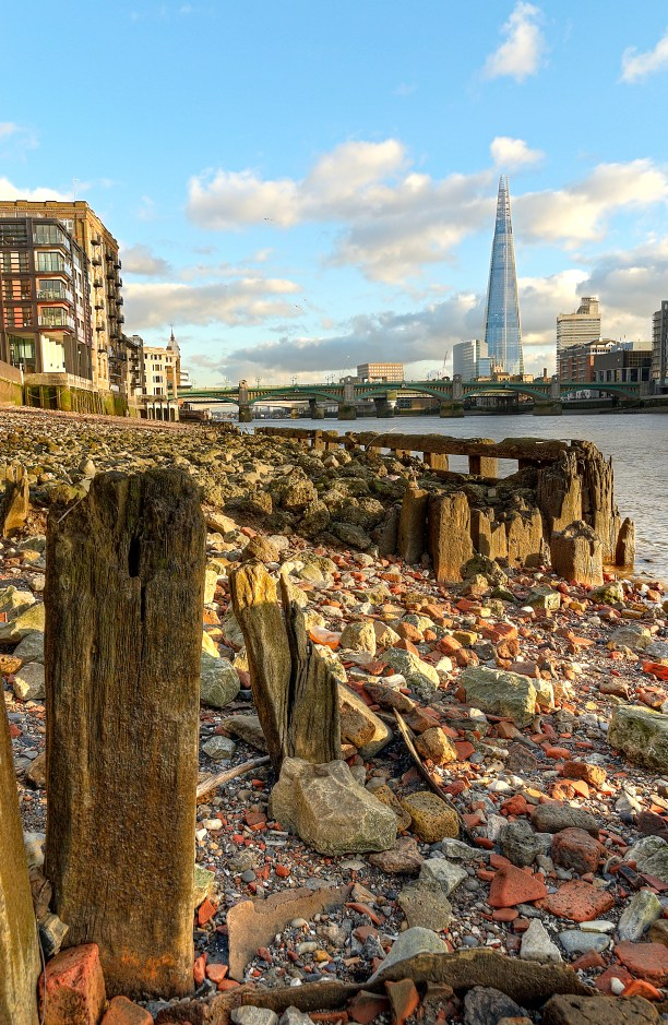 The Shard, Thames river at low tide, London
