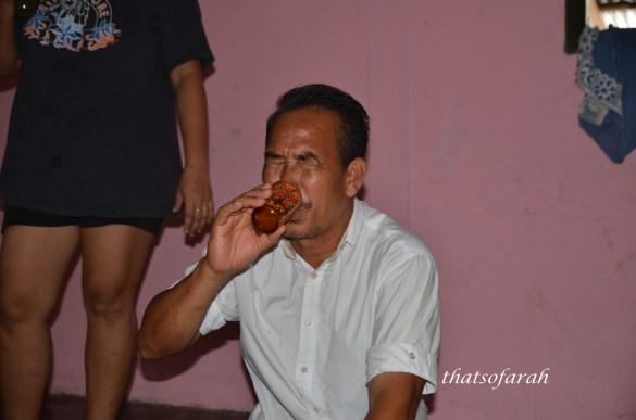 Tuak drinking