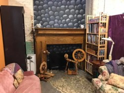 SPARKLE's storybook loft area with cobblestones, spinning wheels, and fake fireplace