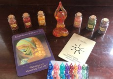 Rainblow Blessings and Sun oracle cards, card with goddess figurines, 6 mini bottles of gemstones, 1 goddess