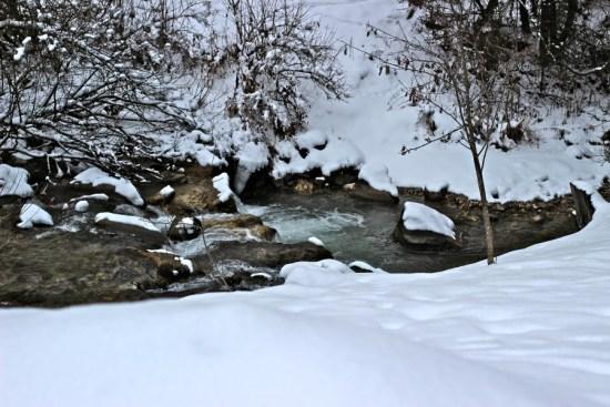 snowy river in canazei