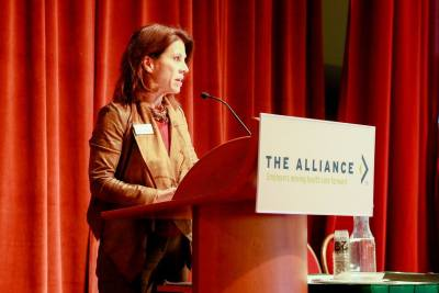 Cheryl DeMars speaks at an event