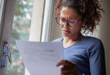 Woman looking at surprise medical bill