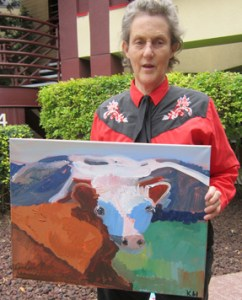 """Temple Grandin with Kevin Hosseini's """"Cow"""" painting"""
