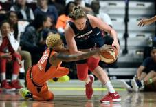 Connecticut Sun's Courtney Williams, left, trites to take the ball from Washington Mystics' Emma Meesseman during the first half in Game 3 of basketball's WNBA Finals, Sunday, Oct. 6, 2019, in Uncasville, Conn. (AP Photo/Jessica Hill)