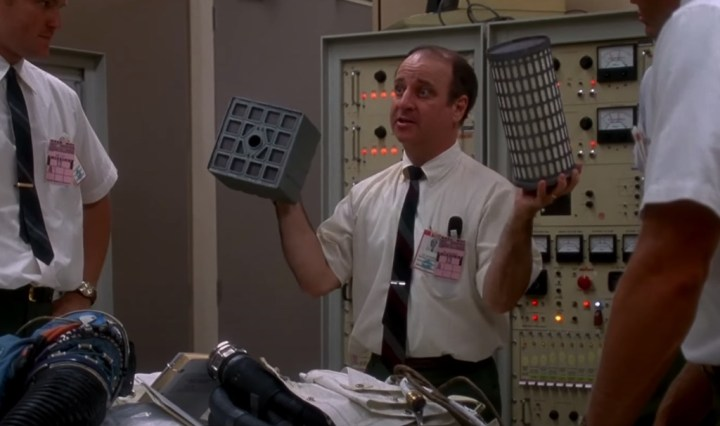 scientist holding air filter parts in the film Apollo 13