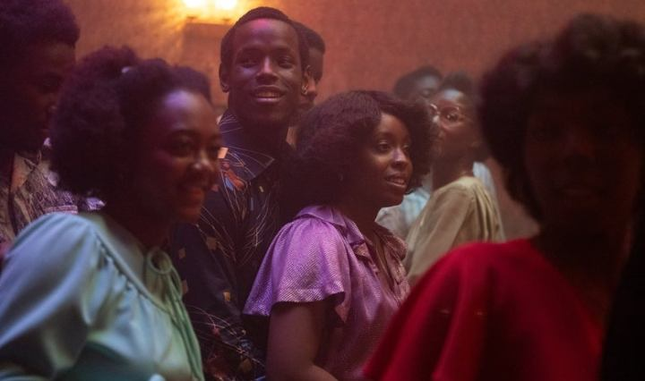 "a group of Black youth on a dance floor in a scene from ""Lovers Rock"""