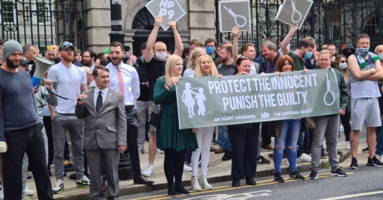 A photo of people attending the far-right rally in Dublin on Saturday July 11th which called for the resignation of children's minister Roderic O'Gorman.
