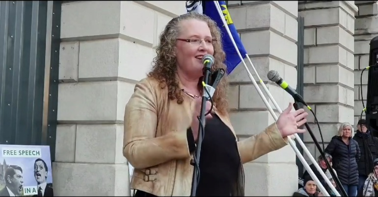 A photo of chair of the Irish Freedom Party at a rally outside the Custom House in Dublin where she told crowd leaders will be put on trial for agreeing to lockdown measures.