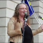 A photo of chair of the Irish Freedom Party, Dolores Cahill, at a rally outside the Custom House in Dublin where she told crowd leaders will be put on trial for agreeing to lockdown measures.