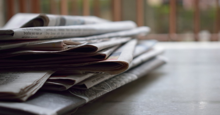 A photo of a pile of newspapers, similar to the ones which have been debating whether or not trans people should have rights.