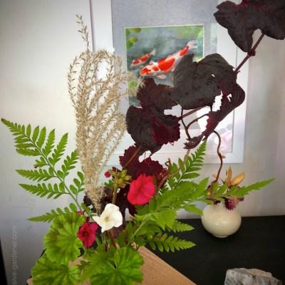 Winter Floral Bouquet in an ikebana vase | Plants: ornamental grape, fern, pelargonium, miscanthus