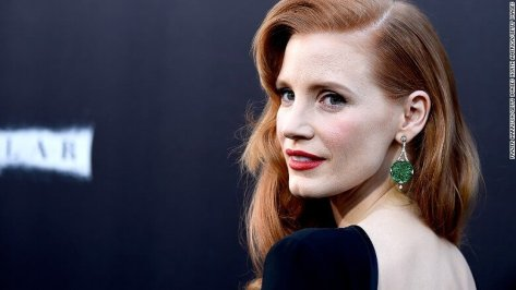 "Actress Jessica Chastain shows off her jade earrings at the 2014 premiere of ""Interstellar"" in Hollywood, California."