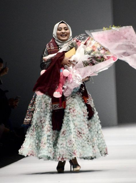 "The Muslim designer was inspired by her hometown Jakarta and sent models down the runway wearing hijabs with trousers, suits, and gowns. At the end of her show, she received a standing ovation and said, ""This is my dream come true."""