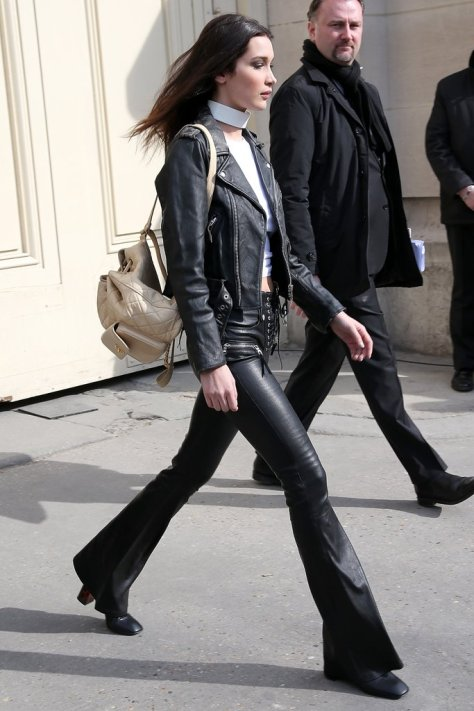Bella walked confidently out of the Chanel show in an all-leather look, accessorizing with her Chanel quilted backpack.