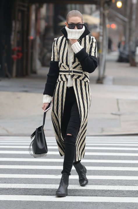 Gigi Hadid pulled up her turtleneck for warmth during a windy day in NYC.
