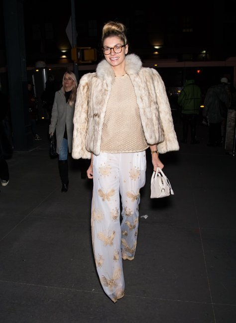 Jessica Hart invested in a tan fur coat that would go with every Winter outfit.