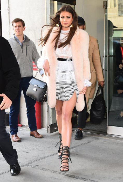 Taylor Hill looked sweet and feminine thanks to her pale pink coat and lace shirt.