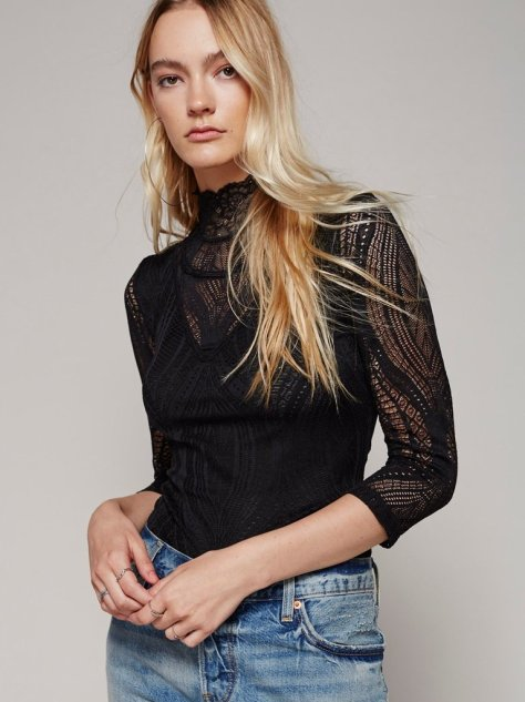 """With an eye on 2017's biggest trends, I want to invest in a high-neck top. Right now I'm all about this lacy quarter-sleeve number ($50) from Free People. Maybe I'll wear this with my snap button pants."" — ML"