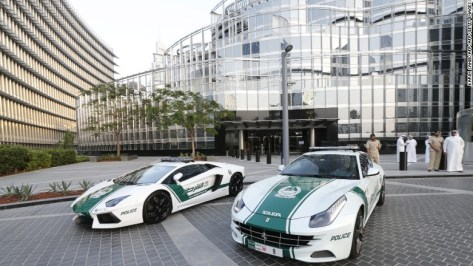 Two of the first supercars to be added to the fleet were the Lamborghini Aventador (left) and Ferrari FF (right), pictured here at the foot of the Burj Khalifa.