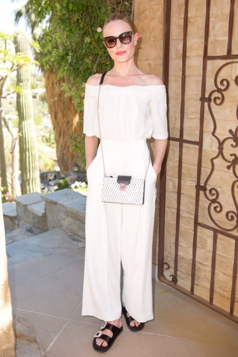 Kate Bosworth wearing a breezy white look, embellished sandals, and an MCM bag at The Zoe Report's Zoeasis party.