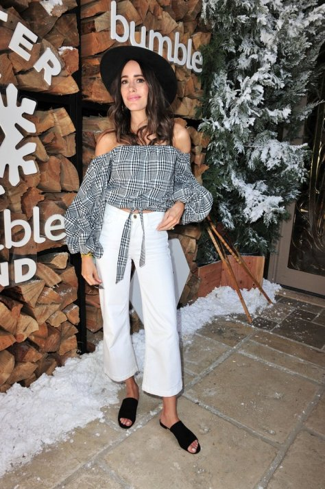 Louise Roe wearing an off-the-shoulder gingham top, white jeans, and slides at the Winter Bumbleland party.