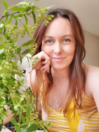 Maggie bio photo with flowers