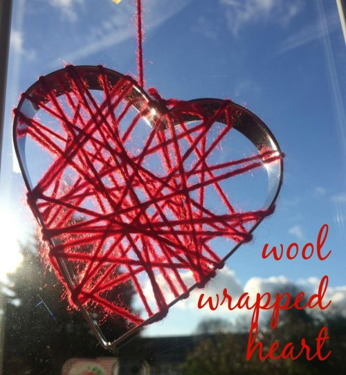 red wool wrapped heart in window
