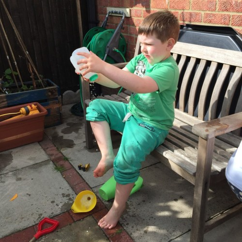recycled milk bottle watering can
