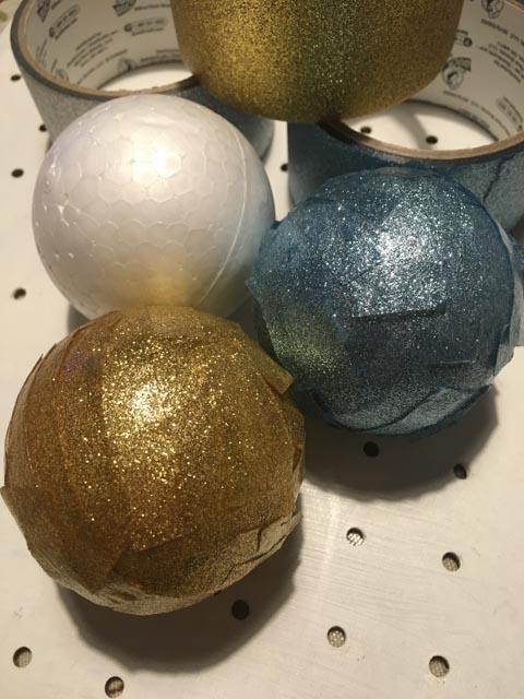 balls covered in Duck Glitter tape