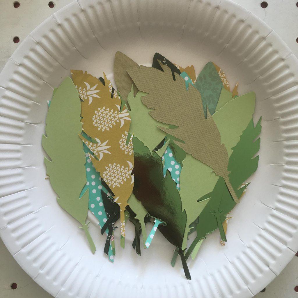 Paper plate laurel wreath craft for kids