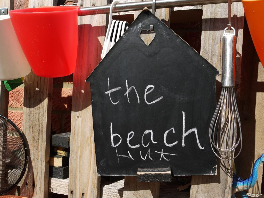 a beach themed mud kitchen