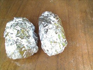 potatoes wrapped in foil, ready for the bbq