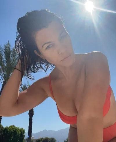 Kourtney Kardashian Snaps a Natural Selfie in Red