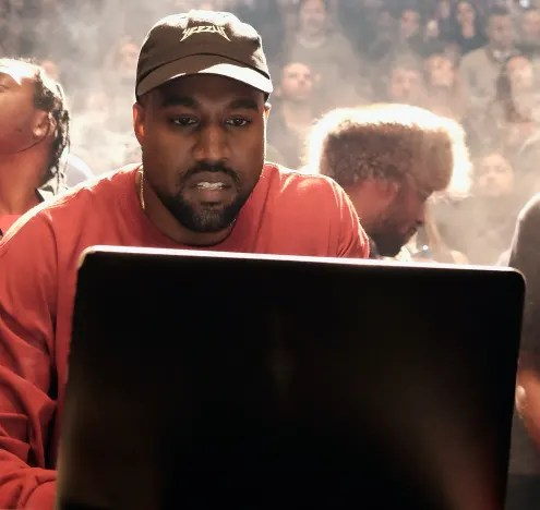 Kanye West at a Computer