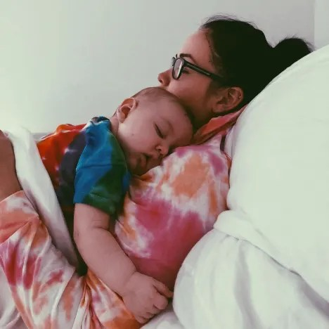 Paola Mayfield Rests with Baby Axel