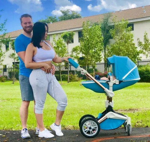 Paola Mayfield Poses with Russ and Stroller
