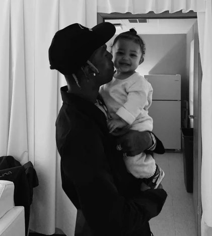Travis Scott Cradles Baby Stormi Webster