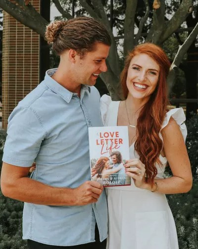 Audrey and Jeremy with Their Book