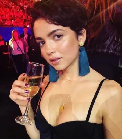 Bekah Martinez Drinks Champagne
