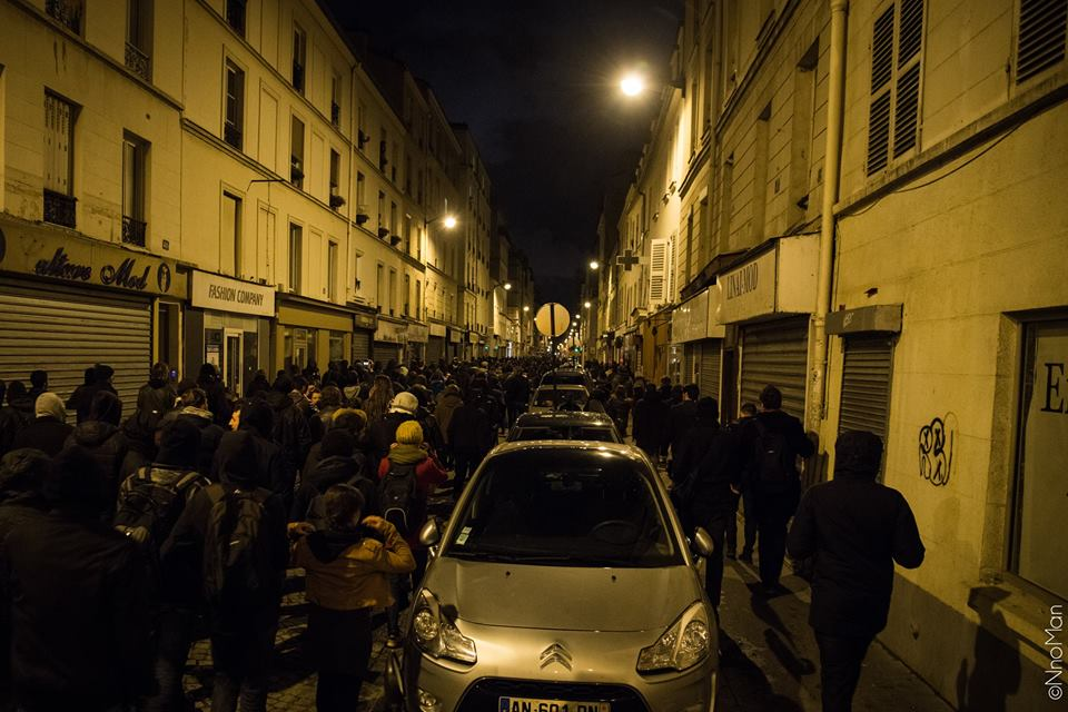 """Nuit Debout"": In the middle of the night, protesters walking together towards Manuel Valls's house to demand justice. ©NnoMan"