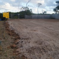 Dirt has been shifted and smoothed out ready for surveyor to mark out