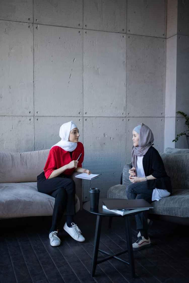 multiracial muslim women talking about business strategy