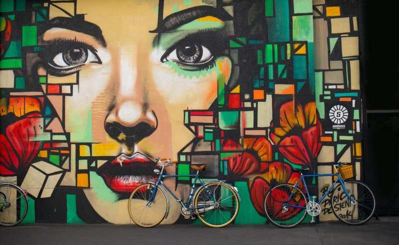 Bike in front of mural.