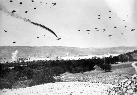 German paratroopers landing on Crete, May 1941. The activities of a German intelligence gathering division during this battle inspired Fleming to develop the 30 Assault Unit, who he hoped would do the same for the British.
