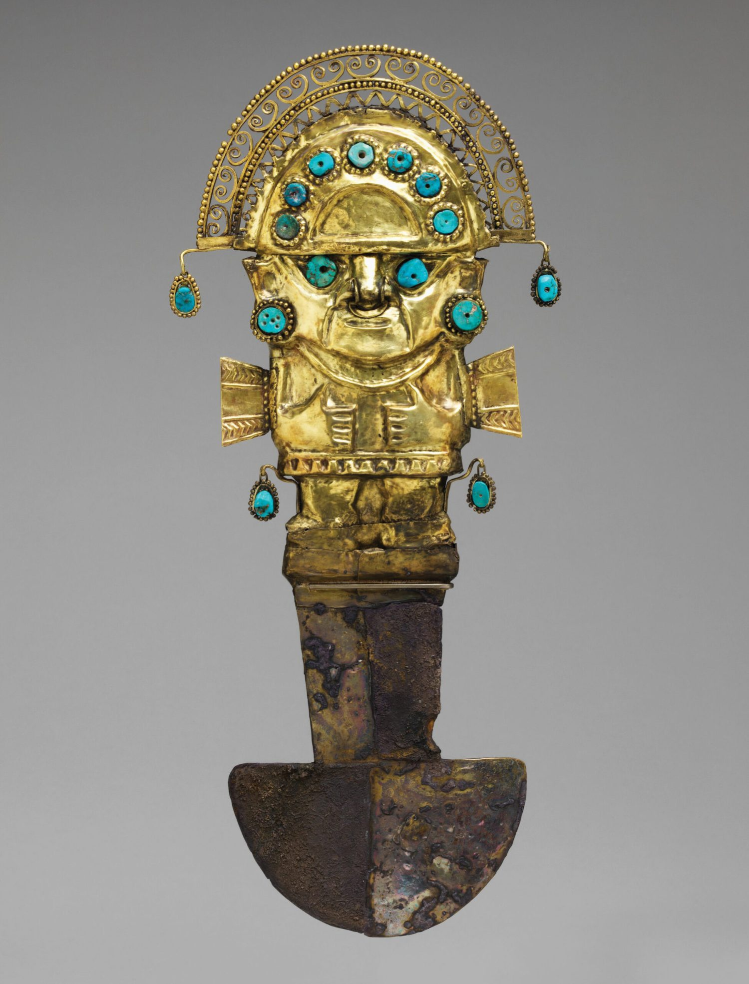 below A Sicán ceremonial knife, or tumi, from the north coast of Peru. Gold, silver, and turquoise, 10th-12th century AD. Size: 36.2 x 15.9 x 4.1cm opposite Tiwanaku ear ornaments, from coastal Peru or highland Bolivia. Shell, stone, silver, and copper, AD 400-800. Size: 6.5cm diameter