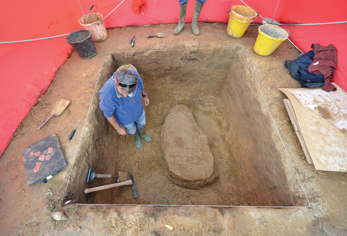 BELOW Archaeologists work to prepare the hoard for lifting. It was excavated as a single piece, weighing around a ton.