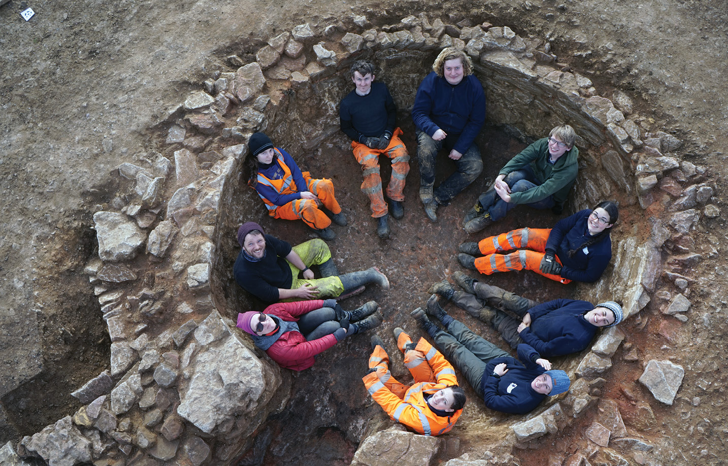 BELOW One of the site's star finds: a well-preserved lime kiln that was so large it could comfortably accommodate the whole excavation team.