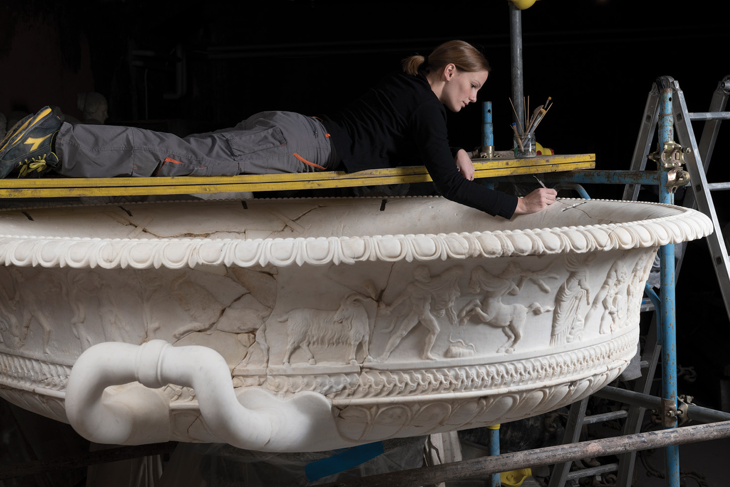 LEFT Restoration being undertaken by Elena Cagnoni on a huge marble vase, dating to the 1st century BC. It was discovered along the via Appia in 1762, and shows the 12 tasks of Hercules.